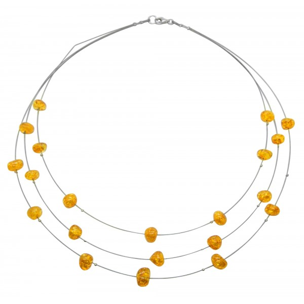 Collier de perles d'ambre couleur miel