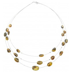 Green amber necklace on steel wire