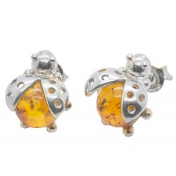 Silver earring and amber stone in the shape of a big ladybug