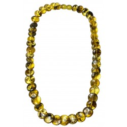 Woman necklace with green amber button
