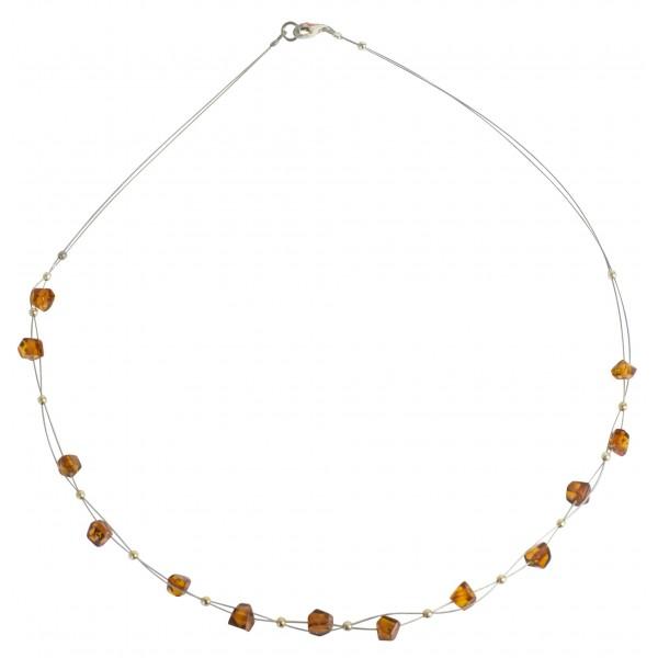 Collier d'ambre perle couleur miel sur cable acier