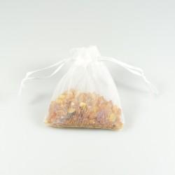 Bag of raw natural amber in its white organza bag