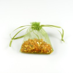 Bag of raw natural amber in its green organza bag