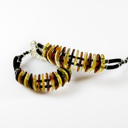 Modern natural amber bracelet, half moon stone